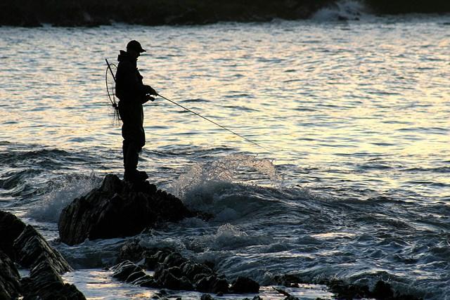 Bass angler at dawn
