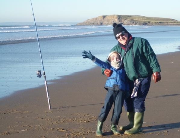 Grandfather & Grandson fishing on the beach