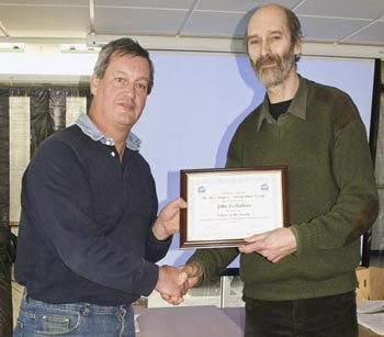 John Leballeur being presented 'Fellow of the Society'
